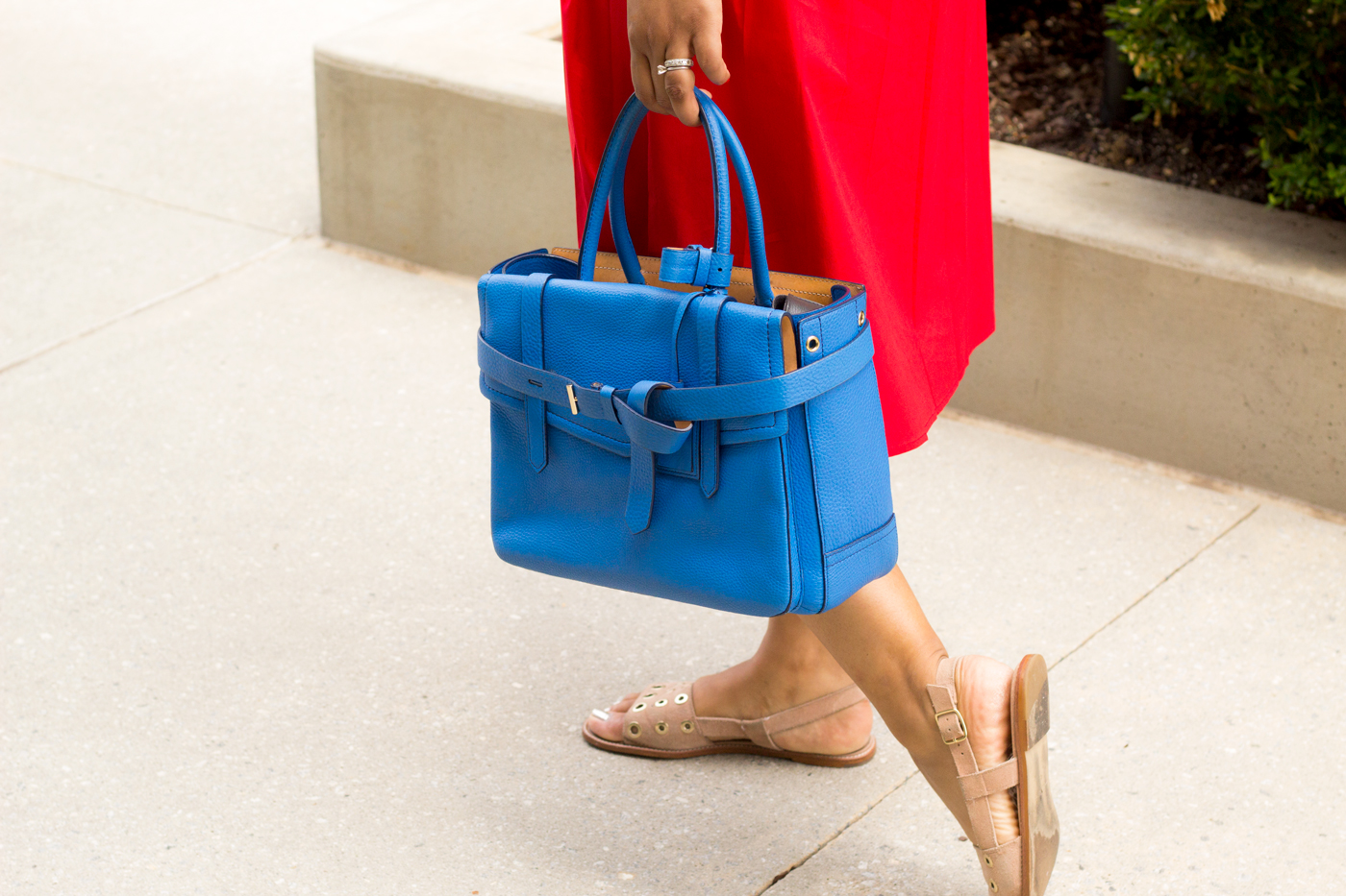 red-dress-blue-bag